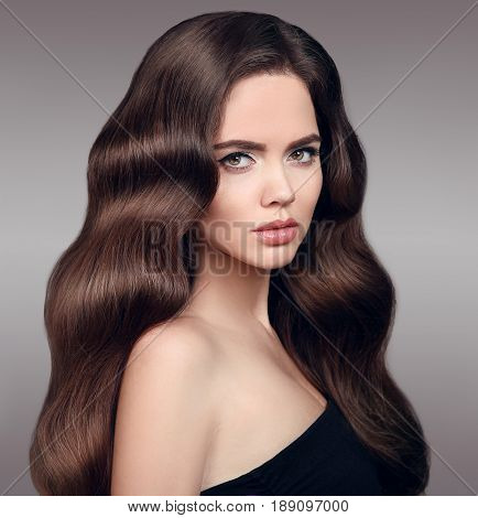 Beauty Hair. Beautiful Model Girl With Clean Fresh Skin And Shiny Brown Straight Wavy Long Hair Isol