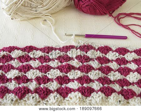 Two toned crocheted shell pattern and wool