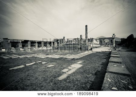 Pompeii forum in Black and white. Pompeii was destroyed, and completely buried, during a long catastrophic eruption of the volcano Mount Vesuvius spanning two days in AD 79.