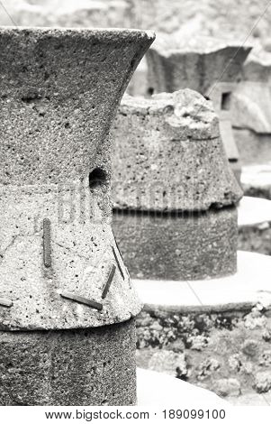 Black and white of Ancient bread ovens in the city of Pompeii. Vesuvius's eruption. Naples, Campania, Italy
