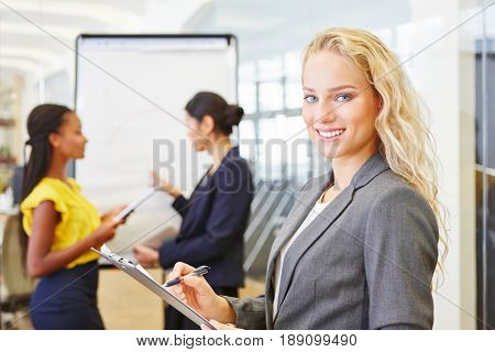 Woman as consultant in business seminar at start-up company