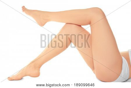 Epilated legs of young woman on white background