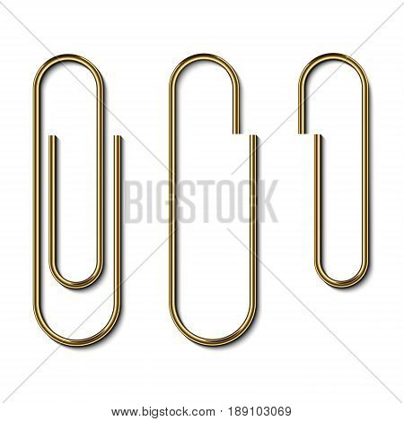 Metal gold paperclips isolated and attached to white paper