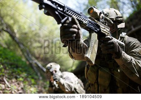 Group of soldiers in woods during day
