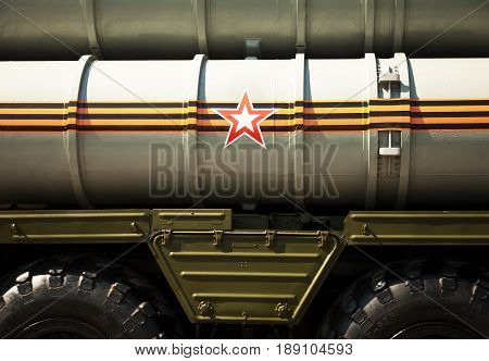 Russian army background: rocket launcher decorated with St. George ribbon and a star symbol. Missile system vehicle close-up backdrop