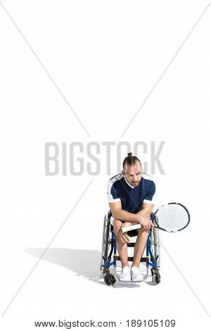Disabled Young Man Sitting In Wheelchair And Holding Tennis Racquet