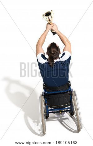 Disabled Tennis Player In Wheelchair Holding Goblet Isolated On White
