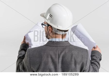 Back View Of Disabled Architect In Wheelchair With Blueprint Isolated On White