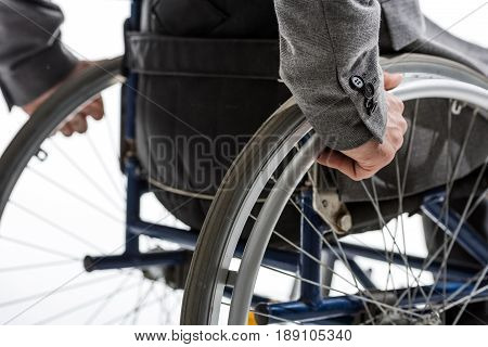 Cropped Shot Of Physically Handicapped Man On Wheelchair Isolated On White