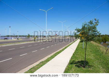 A empty new avenue recently inaugurated at sunny day