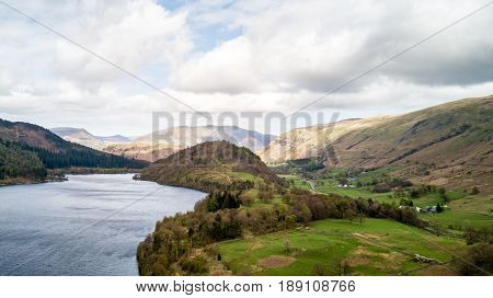 Thirlmere and Great How, Lake District, England. Aerial drone view north over Thirlmere reservoire in the English Lake District with the mound of Great How in the centre of the frame.