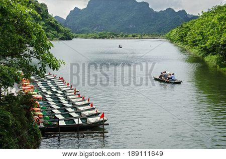 Boat with tourist travel around trang an Vietnam world heritage with moutain rivel and sky.