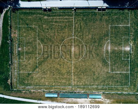 Aerial view of real soccer pitch top view of football sport field in drone pov