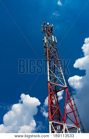 GSM communication repeater tower against blue sky