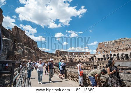 Rome, Italy. 16 May 2017 : Tourists Visiting Colosseum An Oval Amphitheatre In The Center Of The Cit