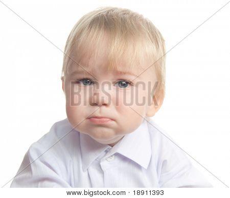 Sad little boy isolated on white