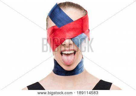 Woman With Wrapped Face With Ribbons Sticking Tongue Out Isolated On White