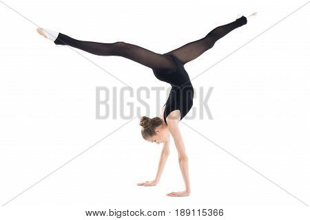 Athletic Young Woman In Sportswear Doing Handstand Isolated On White