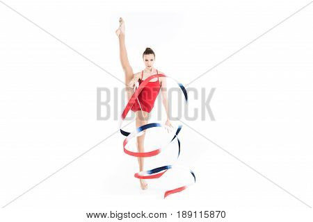 Young Caucasian Woman Rhythmic Gymnast Training With Colorful Rope
