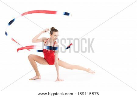 Young Woman Rhythmic Gymnast Stretching With Colorful Rope And Looking Away