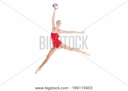 Young Caucasian Woman Rhythmic Gymnast Jumping With Ball