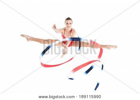 Young Woman Rhythmic Gymnast Jumping With Colorful Rope And Looking At Camera