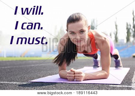 Weight loss motivation concept. Young woman doing plank at stadium. Text I WILL, I CAN, I MUST on white background