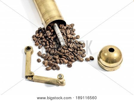 Manual grinder, old  manual coffee mill on white background