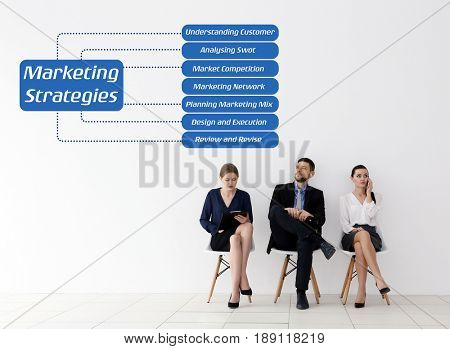 Scheme of MARKETING STRATEGIES and managers on light wall background