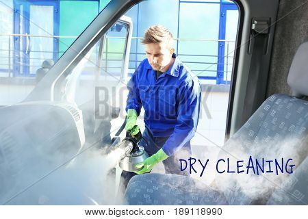 Employee cleaning car salon with hot steam. Concept of dry clean