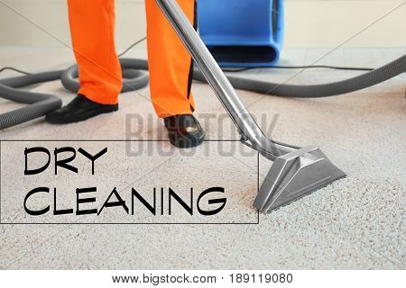 Concept of dry cleaning service. Employee removing dirt from carpet, closeup