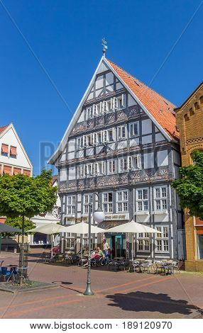 STADTHAGEN, GERMANY - MAY 22, 2017: People at a cafe on the central market square of Stadthagen, Germany