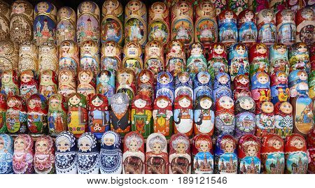 MOSCOW, MAY 26, 2017: Different colors Russian dolls matreshka at souvenir market shop. Traditional classic Russian handicraft art background. Famous classical and modern russian dolls matreshka toys