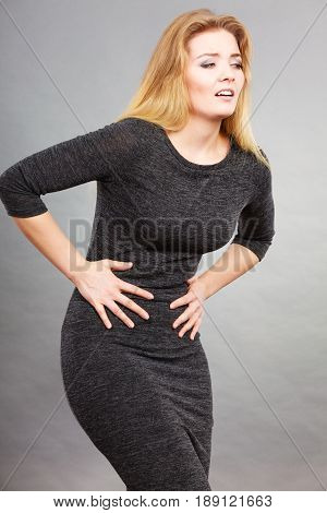 Woman Feeling Stomach Cramps Holding Her Belly