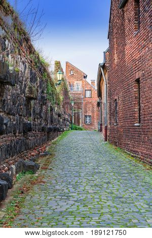 Small alley with city wall of the city of Zons Germany.