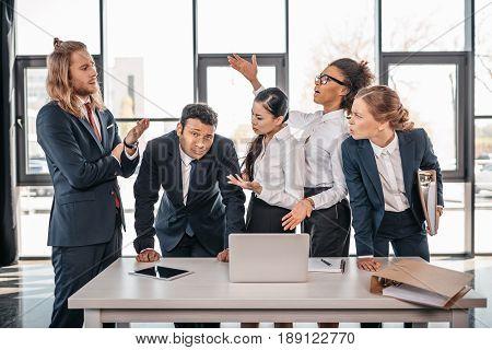 Multicultural Business Team Quarreling In Office, Brainstorming Team Concept