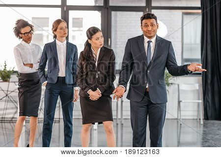 Young Businesspeople In Formalwear Posing While Standing At Modern Office, Multicultural Business Te