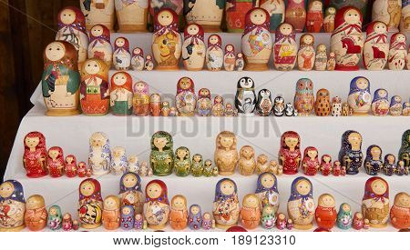 MOSCOW, MAY 26, 2017: Different colors Russian dolls matreshka at souvenir market shop. Traditional Russian handicraft hand made dolls. Famous classical and modern russian dolls matreshka toys