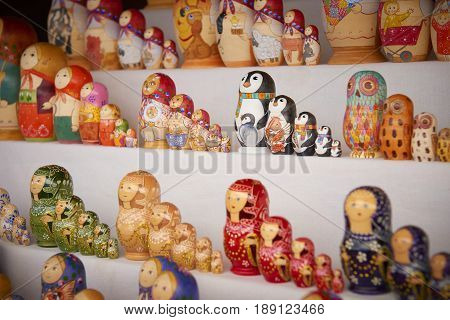 MOSCOW, MAY 26, 2017: Different styles Russian dolls matreshka at souvenir market shop. Traditional Russian handicraft hand made dolls. Famous classic and modern russian dolls matreshka toys. Penguins
