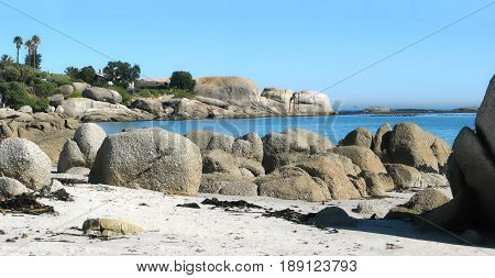FROM CLIFTON, CAPE TOWN, SOUTH AFRICA, HUGE BOULDERS IN THE FORE GROUND AND BACK GROUND