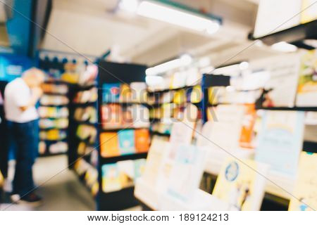 Education Concept Blurred People Shopping And Reading Book In Bookstore