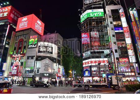 SHINJUKU - MAY 28: Japanese and tourists walking shopping at Shinjuku (large entertainment business and shopping area around Shinjuku Station) on May 28 2017 at Shinjuku in Tokyo Japan.
