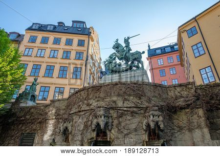 STOCKHOLM, SWEDEN - MAY 21, 2017: Statue of Saint George and the dragon in medieval Old Town of Stockholm. The historic Old Town is a major tourist attraction.