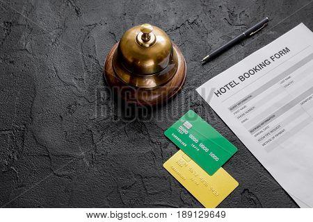 hotel reception desk with booking form on dark background