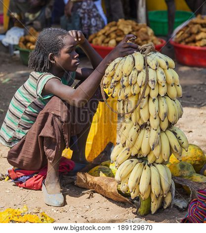 Women From Konso Tribal Area Sell Bananas At Local Village Market. Omo Valley. Ethiopia