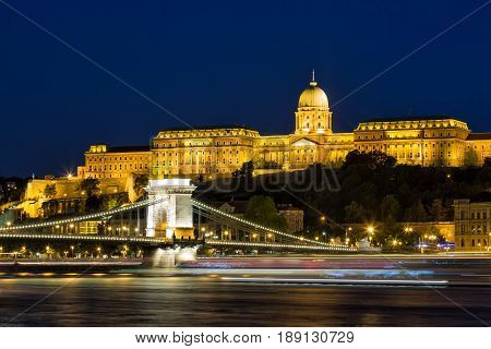 Budapest by night - Night view of the Szechenyi Chain Bridge, that spans the River Danube between Buda and Pest and Buda Castle.
