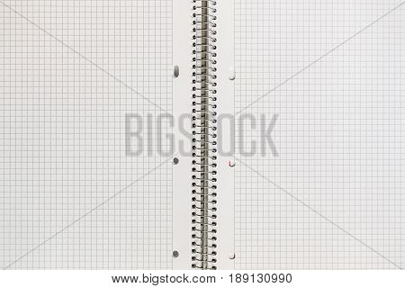 An Open Notebook In A Cage Close Up. Mock Up