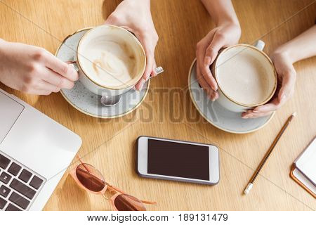 Partial View Of Women Drinking Coffee On Coffee Break