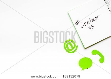 client support service workdesk with contact us mail signs on white background top view mockup