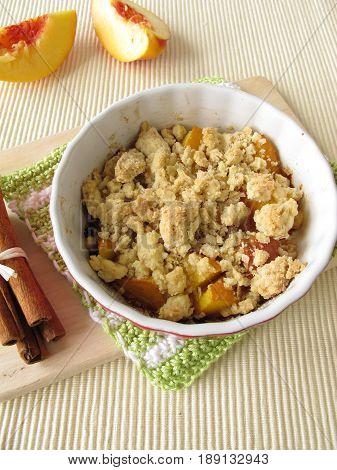 Homemade nectarine crumble with cinnamon and fresh fruits